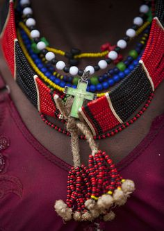 Close-up On The Colourful Necklaces Of A Hamar Tribe Girl, Turmi with Jesus cross, Omo Valley, Ethiopia by Eric Lafforgue on Flickr.