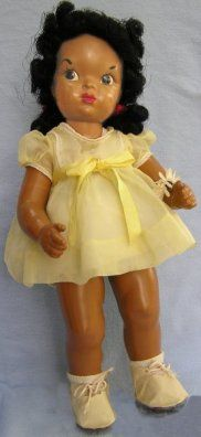 """Jackie Ormes said, """"No more... Sambos... Just KIDS!"""" She transformed her attractive, spunky Patty-Jo cartoon character into the first upscale American black doll. At long last, here was an African-American doll with all the play features children wanted, and the finest and most extensive wardrobe on the market, with all manner of dresses, formals, shoes, hats, nightgowns, robes, skating and cowgirl costumes, and spring and winter coat sets, to name a few. 1947 thru 1949"""