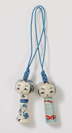 Cute phone strap with miniature kokeshi dolls (Togatta style)