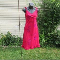 """Express Fuchsia Dress Tie straps Surplice neckline Ruffled hem Gorgeous fuchsia with floral print. Measured flat 15"""" across bust 36"""" long without straps Knee length on 5' 9""""person On 30"""" x 23"""" x 30"""" mani Pinned to fit Tagged 7/8 Express Dresses Midi"""