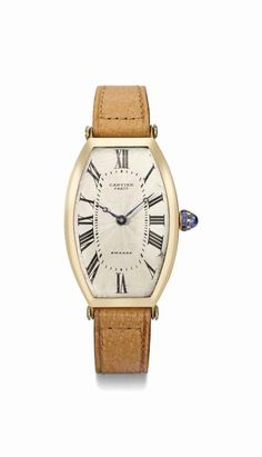 Cartier. A fine and historically significant 18K gold tonneau-shaped curved wristwatch, circa 1920 #ChristiesWatches