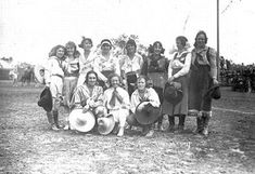 """Cowgirls of the Golden Age of Sport""  circa 1925. Back row, left to right: Florence Randolph, Ruth Roach, Mabel Strickland, Reine Hafley Shelton, Mildred Douglas, Bonnie McCarroll, Rose Smith, and Unidentified. Front row, left to right: Bea Kirnan, Mayme Stroud, and Fox Hastings. Photo by Ralph Russell Doubleday, who took many of the great photos of women in rodeo and trick riding."