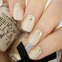 Beautiful nude and glitter manicure
