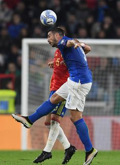 Graziano Pelle of Italy jumps for the ball during the FIFA 2018 World Cup Qualifier between Italy and Spain at Juventus Stadium on October 6, 2016 in Turin, Italy.