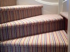 Make your stairs & landing a feature by adding a colourful, striped carpet. We fitted this candy striped carpet this year, complete with winders & bull nose. Its a contemporary look, that looks sophisticated too. Striped Carpet Stairs, Striped Carpets, Stair Landing, Candy Stripes, Carpet Design, Lounge, Couch, Flooring, Contemporary