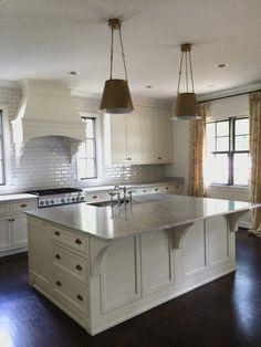 Brass, Marble and White!! Nothing better. White Dove custom cabinets, Visual Comfort brass pendants, Rohl faucet, custom hood, Walker Zanger backsplash, Quadrille draperies.  Meg White Interiors