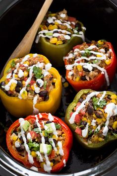 Mexican Slow Cooker Stuffed Peppers | Loaded with enchilada sauce, black beans and corn. A quick, easy and satisfying meal! | From: chef savvy.com