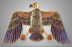 Golden Vulture pendant from tomb of King Tut.  The Vulture represented Upper Egypt and was also the symbol of the the goddess, Mut - one of the great Mother Goddesses of Ancient Egypt - she was particularly associated with the Pharaohs.  The Vulture is holding Shen symbols in its talons.  The Shen represents, among other concepts, the idea of Eternity.   --ds