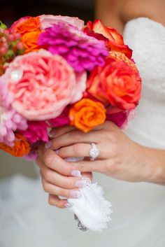 Patti's ring sparkled against the bright peony based flowers she carried down the aisle.  A pop of color is a wedding must do, and what better way to add than in your flowers.  Photos by Clane Gessel Photography | #weddings #flowers #bridalbouquets