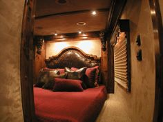 Custom Bed by Outlaw Conversions in the nose of a Horse Trailer