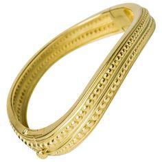 "Kieselstein - Cord Bangle Bracelet. A simply elegant curved ""Caviar"" bangle bracelet created by Barry Kieselstein-Cord"