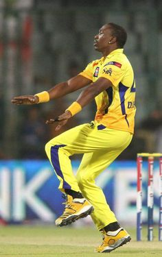Dwayne Bravo of Chennai Super Kings celebrates Lasith Malinga of Mumbai Indians wicket during the qualifier 1 match of the 2013 Pepsi Indian Premier League between The Chennai Superkings and the Mumbai Indians held at the Feroz Shah Kotla Stadium, Delhi on the 21st May 2013