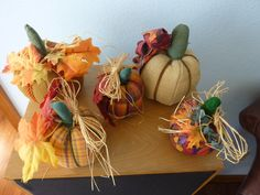 Pumpkins made of various fabrics with ribbon/cord, raffia and dried flowers