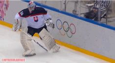 The goalie of Slovakia - Jan Laco - does the greatest tackle in the whole Olympic games.  I believe this is more like a hip check!