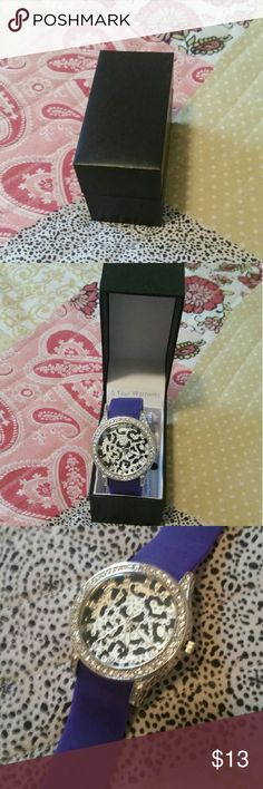 Purple Strapped Zebra Face Watch - Black and white zebra faced watch - Rubberized/silicon purple straps (easy to clean off!) - 9 strap holes to fit any size wrist - Rhinestones around face and within watch face - Comes with box and form to get replacement parts if needed in future - Never worn, but includes no batteries  Please let me know if you have any questions & feel free to put in an offer!  *Note: Price reflects watch's pristine condition and inclusion of original box* Accessories…