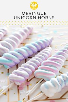 Made using a light and airy meringue batter, these Meringue Unicorn Horns are as magical and sweet as their namesake! Use Wilton icing colors to lightly tint a small portion of batter, then stripe your decorating bag to create a neat piping effect on your treats. A fun party favor for birthday parties, these meringue pops are sure to become a favorite for unicorn lovers of all ages. #wiltoncakes #cookies #cookieideas #meringuecookies #cookiepops #unicorns #unicornparty #magical #unicorntheme