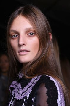 """Could """"tea stained eyes"""" take off? Hmm. Makeup legend Val Garland for NARS Cosmetics set the trend at Erdem, which is always about a spooky beauty look. We love the glossy locks, though. Very wearable."""