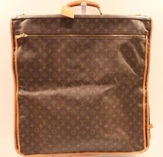 This is a beautiful newer Louis Vuitton piece.  It has the traditional monogram LV with tan leather detailing and brass fittings. On the outside of the bag, it has a large zip pocket area.  Inside the bag it has two hanging components for hanging clothing and 2 large zip pouches.  www.handbagconsignmentshop.com