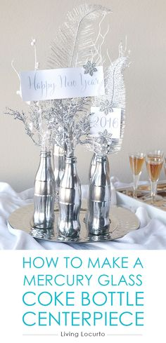 How to Make a Mercury Glass Coke Bottle Centerpiece. Easy DIY Craft with Free Printables for a 2016 New Year's Eve Party! Great last minute idea for party decorations. I love silver and white for the holidays. Add some fake snow and glitter on the table for a winter wonderland. #iworkwithcoke ad