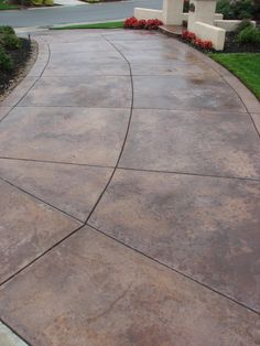 Driveway - stained concrete. Looks great and very affordable.