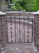 wrought iron gate for a church columbarium, design based on Salisbury 				Cathedral gate