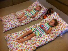 4 Pillows with cases sewn together make a mat for little one's to watch TV or sleep upon.