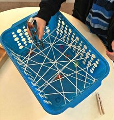 """Bats, Ghosts, Spiders and Haunted Houses """"Grabbing Spiders Through the Web"""" Fine Motor Activity (from The Little Montessori School / Ms. Fall Sensory Bin, Sensory Bins, Kid Science, Motor Activities, Preschool Activities, Preschool Classroom, Children Activities, Halloween Activities For Kids, Preschool Halloween"""