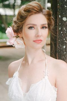 stunning bridal peach makeup, lovely hair with flowers...:)