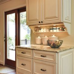 Shelf Under Upper Cabinets bracket corbel, could do this with the brackets extending down from the sides.