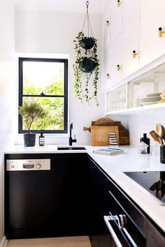 my scandinavian home: Black and white kitchen in a sleek and rustic in a Sydney bachelor pad