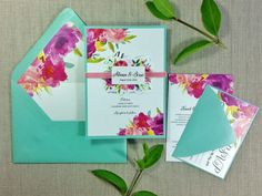 T H E . I N V I T A T I O N . S U I T E . S A M P L E  The details of this invitation will set you apart from the traditional floral invitation. With vibrant colors and a belly-band and velvet ribbon, you guests will be in awe! Each wedding invitation suite includes: 5 x 7 invitation mounted on backing Mint Euro-flap envelope with floral liner (envelope addressing available) 3.5 x 5 rsvp Mint rsvp envelope (envelope addressing available) Floral die-cut belly band with velvet ribbon  quantity…