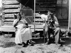 An older couple rest at the end of a work day on a plantation in Tennessee. Associated Press.