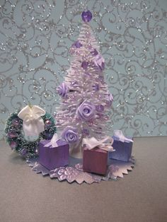 Miniature dollhouse Holiday Christmas tree in Sparkly Purple and White with three tiny Gifts, Wreath, and tree skirt. via Etsy.