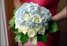 How beautiful is this!!! White roses accented with blue hydrangias!