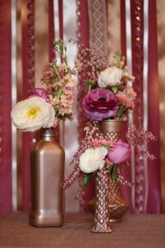 This is a MUST for the fall wedding we are planning for Katie: Bronze-Vases       Look at these, just spray paint old vases, I like this