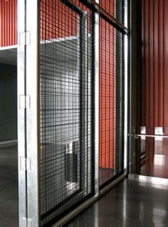 Large scale Banker Wire SJD-3 powder coated wire mesh forms the entrance to the Harley-Davidson motorcycle museum in Milwaukee, Wisconsin.