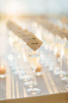 Champagne escort cards: http://www.stylemepretty.com/illinois-weddings/chicago/2017/01/09/skyline-wedding/ Photography: Tim Tab Studios - http://timtabstudios.com/