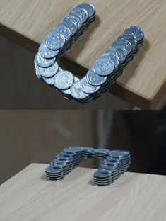 these coins don't fall down placed like this on the edge of the table.