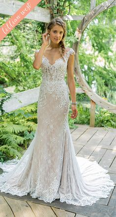7201ebf7449 Style 66012  Your style is emphasized in this modern fit and flare wedding  dress.