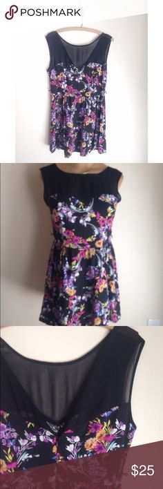 Black and floral flowy lipsy dress Black fit and flare dress with a bright colorful floral print all over. Has a sweetheart neckline and black mesh high neckline top with a deep v in the back. Zips down the back. Sleeveless. Super cute. Has belt loops. Size 10 by lipsy from London. £60 equivalent to $85. lipsy Dresses Mini