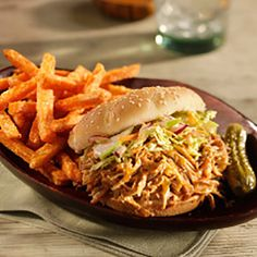 Slow roasted pulled pork recipe seasoned with a dry rub and served with spicy coleslaw.