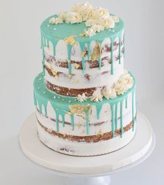 White, teal, and gold cake