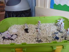 Space figures and white gravel in small tray provide an interesting mini landscape.