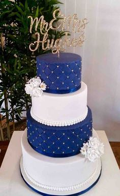 navy blue and white wedding cakes with gold decorations and couple names toppers, spring weddings, wedding food, wedding dessert elegant wedding cakes Royal Blue Cake, Royal Blue Wedding Cakes, Navy Blue And Gold Wedding, Navy Gold, Wedding White, Floral Wedding, Royal Blue Wedding Decorations, Cobalt Blue Weddings, White Gold