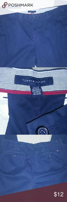 Men's Tommy Hilfiger Navy Dress Pants 38 x 34 These are navy blue, not the blue in the pictures. Men's size 38 x 34. Good, used condition. Two front pockets, with one small penny pocket. Back has two pockets with button closure. Inside waistband is blue and white pinstripe. Bottom cuffs are in good shape. Tommy Hilfiger Pants Chinos & Khakis