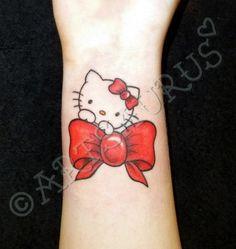 Hello Kitty on bow tattoo.