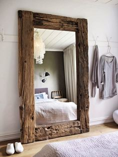 oversize mirror with rustic framing