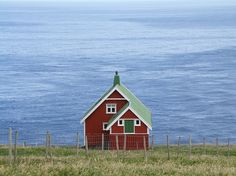 red house in Akraberg, Faroe Islands The village was abandoned in 1988 after the Christmas hurricane.