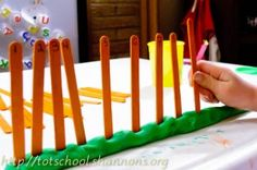 """Good for number sequencing..I will be using it to practice the -teens and twenties! Write one number (11 through 20)  (or 20-30etc) at the top of each of the craft sticks (same # on both the back and the front).  Make a green Play-Doh """"snake"""" (grass).  Mix up the popsicle sticks, have students build a """"fence"""" by putting the numbers in order."""