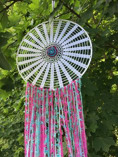 Handmade crochet dreamcatcher. Measurement: - Diameter - 13,8 (35cm) - Length - 35,4 90cm) not including hanging ribbon This beautiful doily dreamcatcher is made of cotton yarn, wire ring, decorative ribbons and pearls. It will be a wonderful decoration of your interior and
